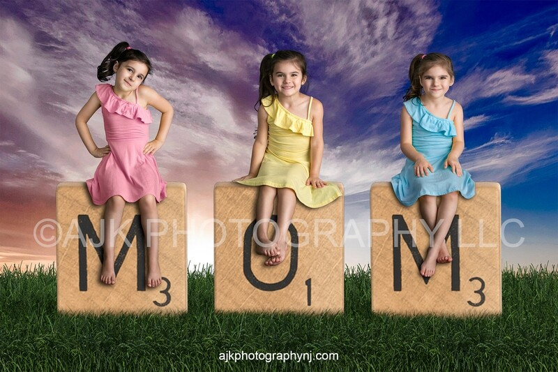 Mother's Day digital background, giant scrabble letters spelling MOM in grassy field and blue sky, digital backdrop