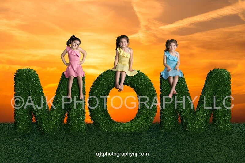 Mother's Day digital background, bush letters spelling MOM in grassy field and gold sky, digital backdrop