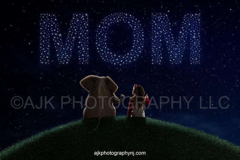 Mother's Day digital background, elephant on grassy hill, stars lit up writing MOM in night sky, digital background