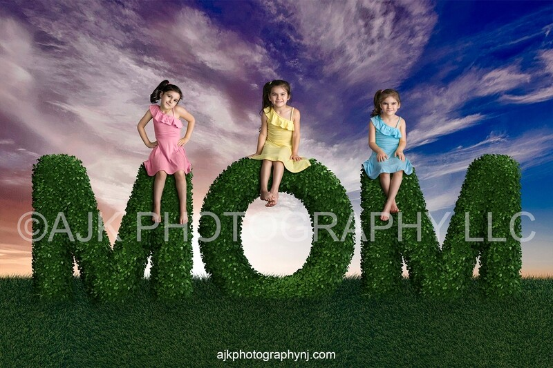 Mother's Day digital background, bush letters spelling MOM in grassy field and a blue sky, digital backdrop