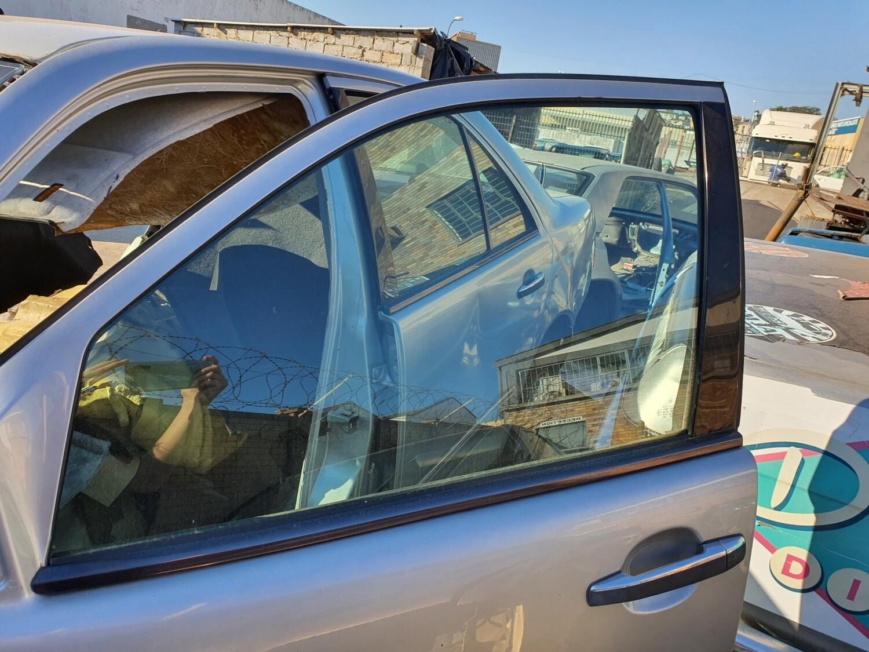 Mercedes-Benz Front Left Glass (W210)