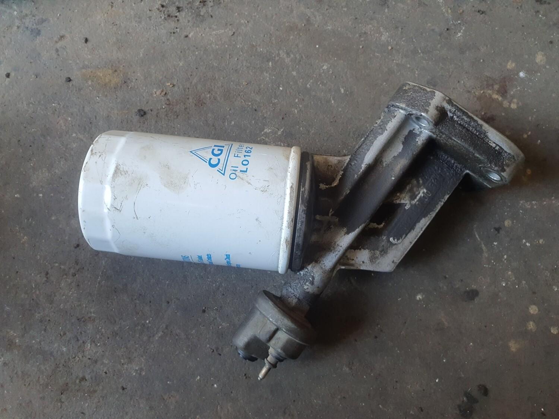 Mercedes-Benz Oil Filter Bracket (W124 M102)