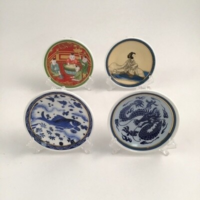 Four Small Plates With Chinese Designs