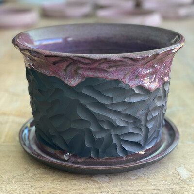 Drippy black clay Planter