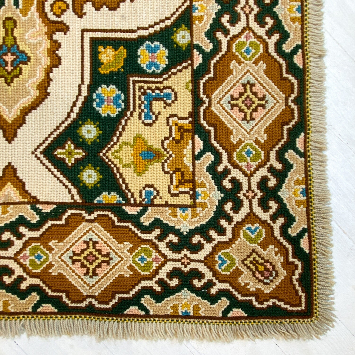 Portuguese carpet by Arraiolos from the 70s with ocher background