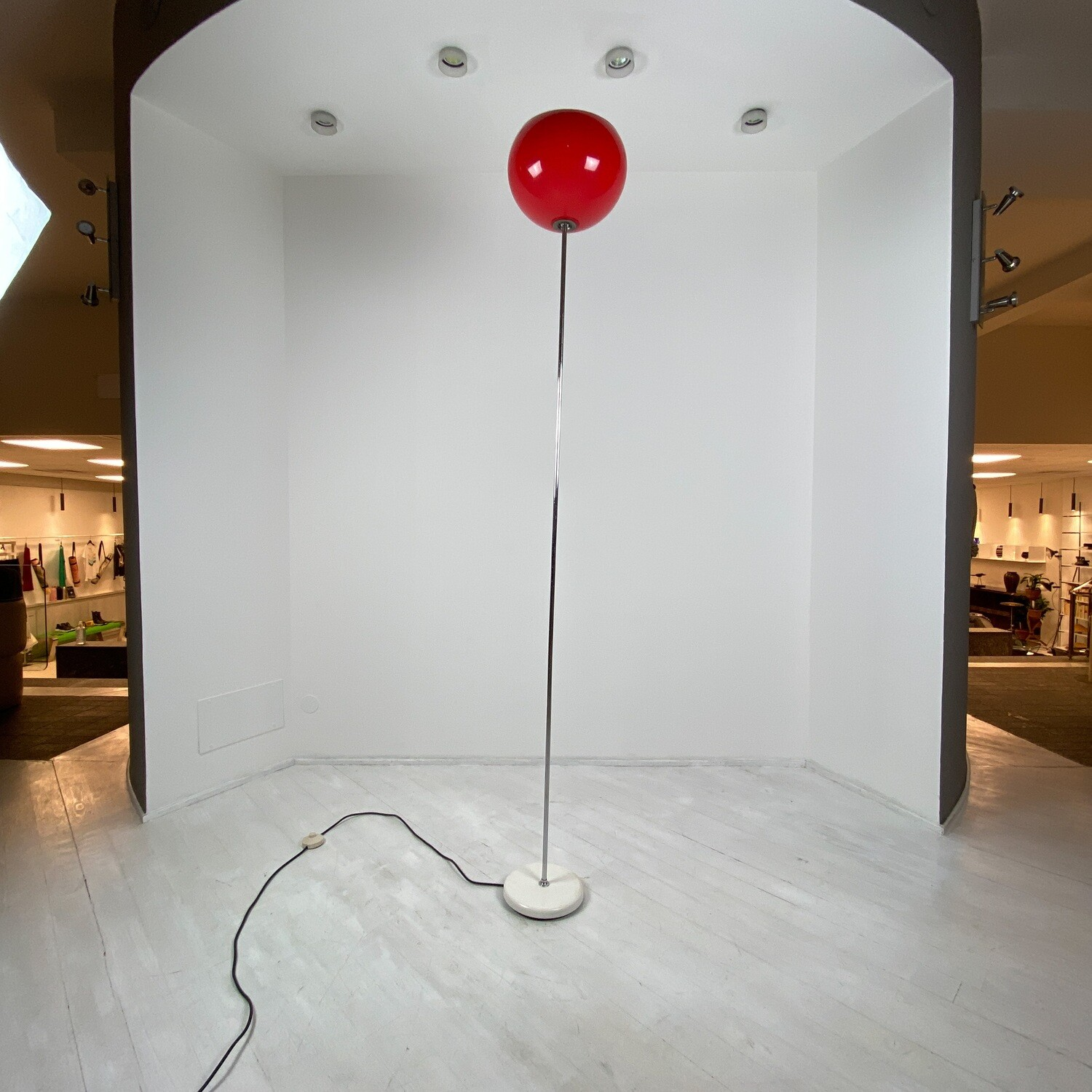 Floor lamp with red lampshade