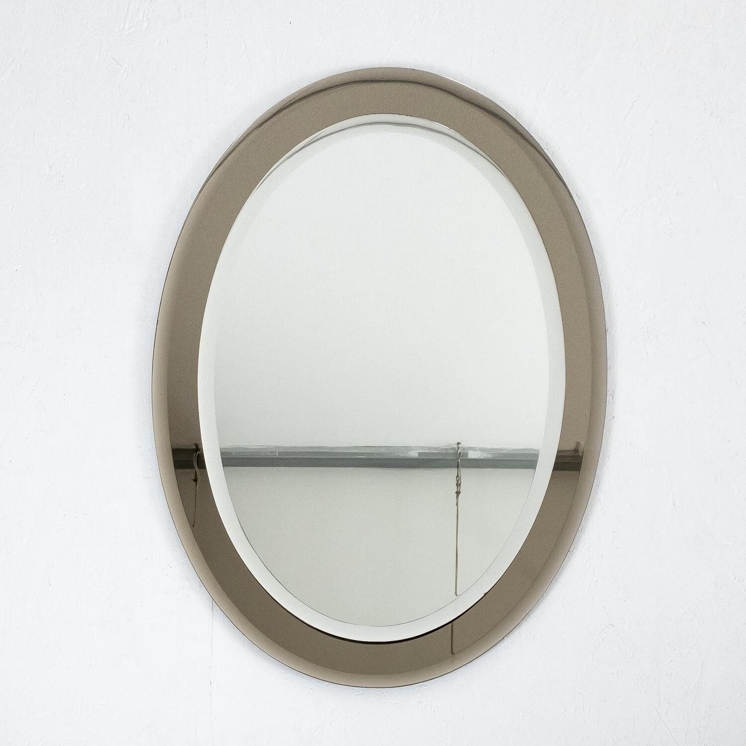 Oval mirror in two-tone glass, Italy 1960s