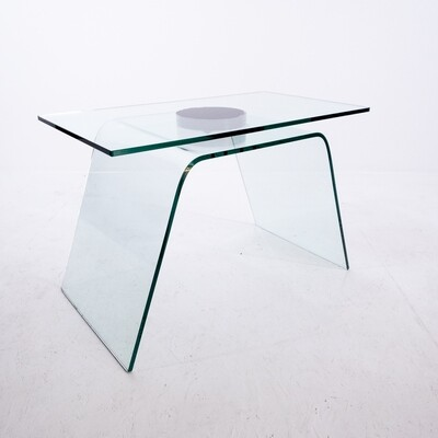 Coffee table in curved glass with revolving top