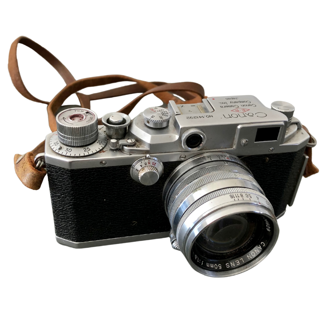 Vintage Canon EP 11F Camera with Rail Mount Flash ModelY Telephoto Lens and GE Exposure Meter in Leather Cases