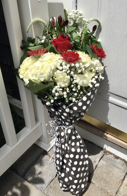 $55 Seasonal Wrapped Bouquet (no vase)
