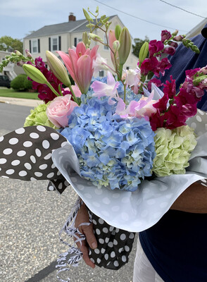 $95 Seasonal Wrapped Bouquet (no vase)