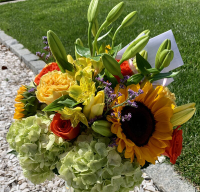 $125 Seasonal Wrapped Bouquet (no vase)
