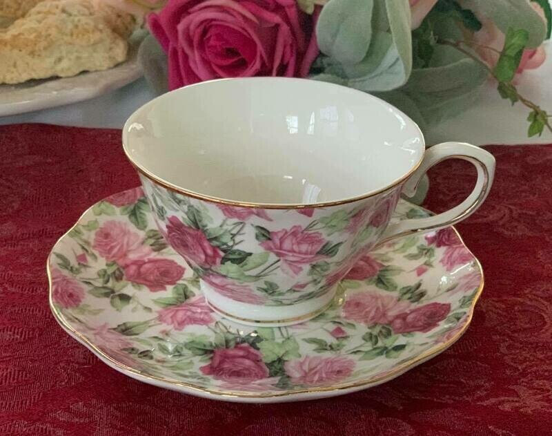 Rose Chintz Ivory Cup and Saucer