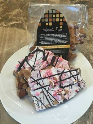 White Chocolate Almond Roca Topped with Crushed Peppermint Candy & Dark Chocolate Drizzle 5 oz Bag From Renee's Roca