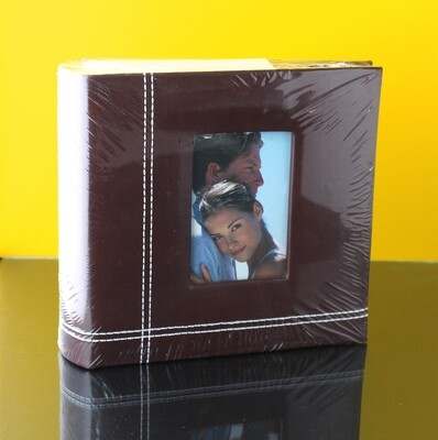 Фото-альбом в кожаном переплёте 100 ф. 10х15