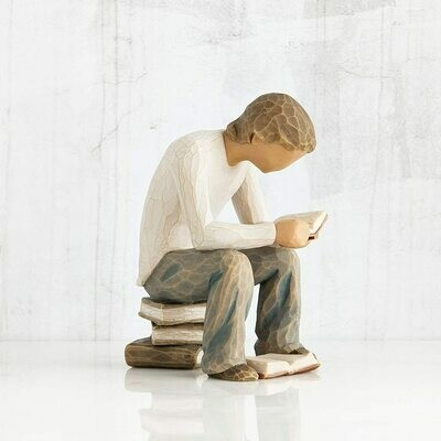 Willow Tree: Quest - Graduation - Boy sitting on pile of books with open book