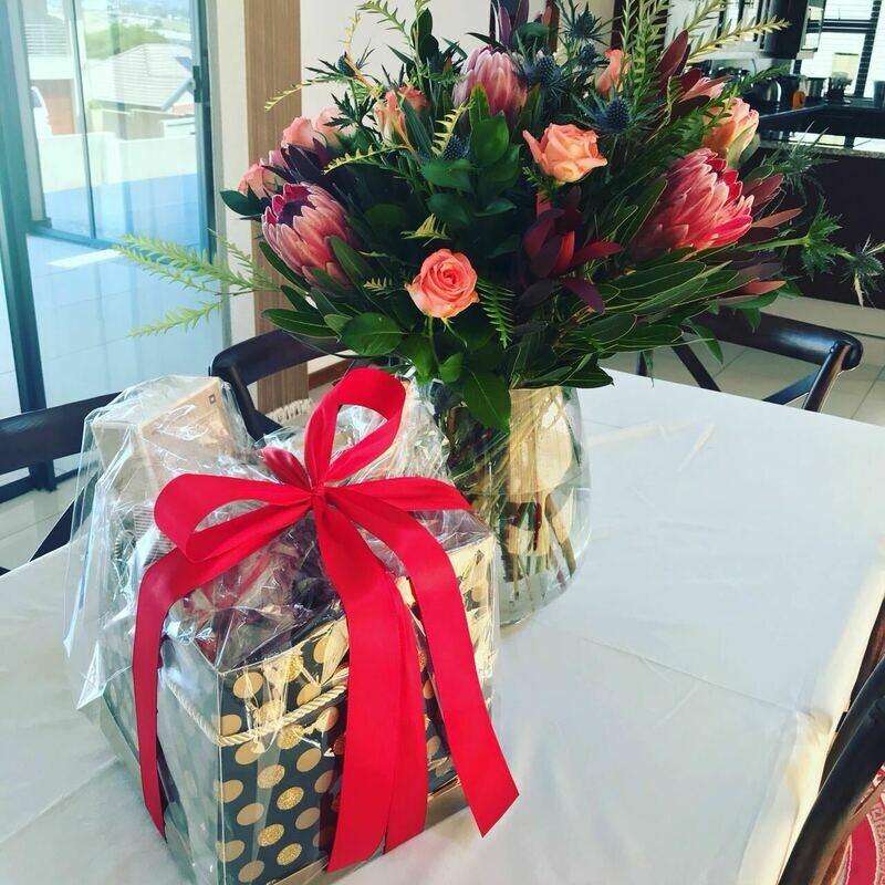 Gift hamper & flowers in a vase
