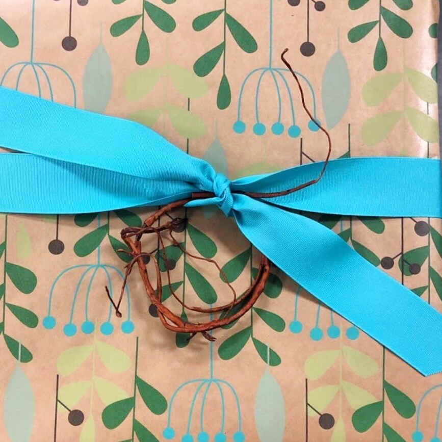 Gift Wrap  W/ Ribbon And Adornment