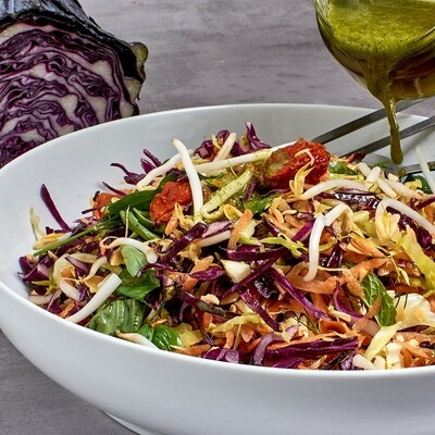 Exotic cabbage salad with fresh herbs, tender greens, bean sprouts and toasted almonds.