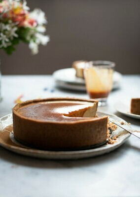 Milktart cheese cake with rum caramel and peanut butter ice cream