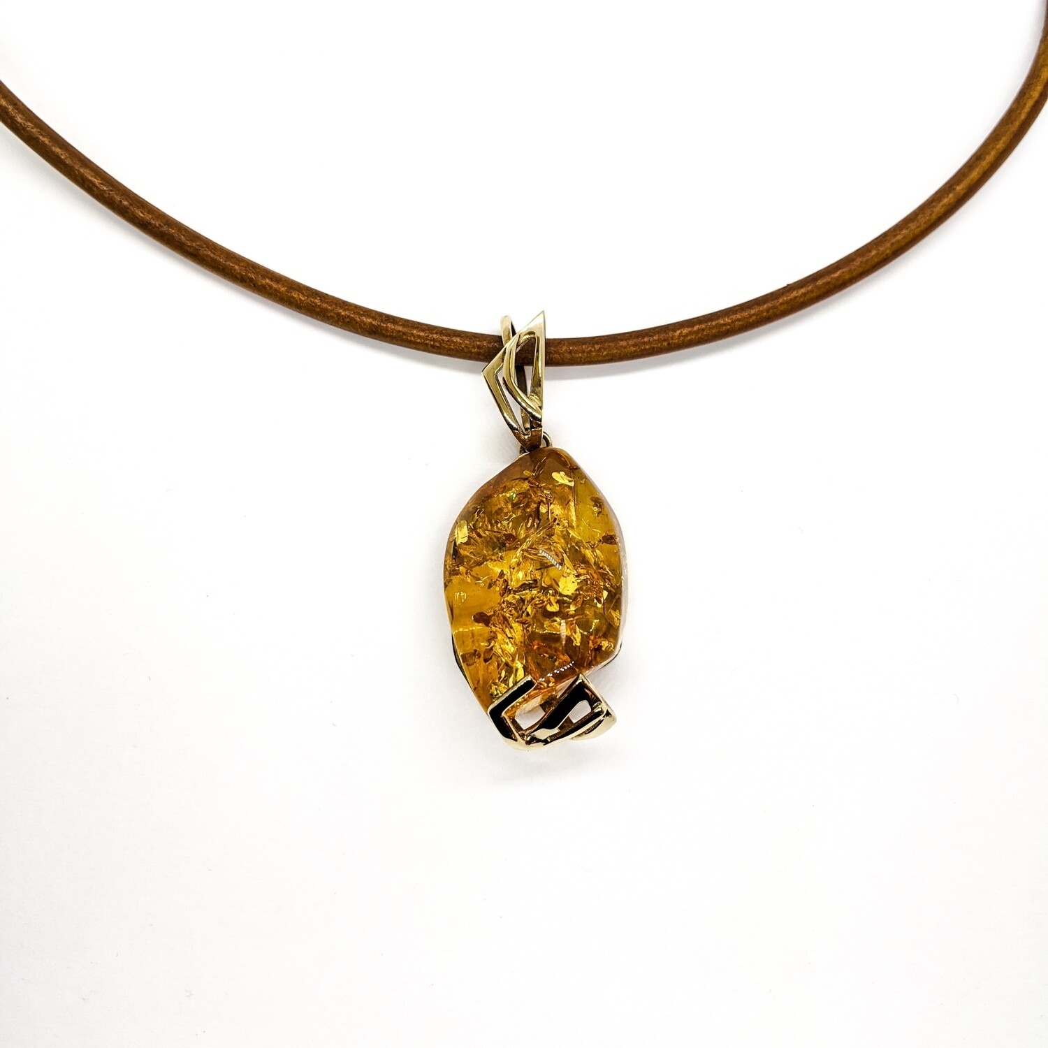 Silver pendant with amber