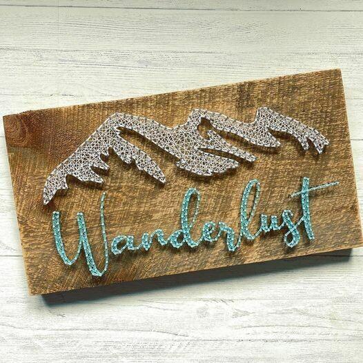 Wanderlust on rustic board