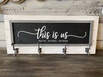 This is us wood plaque with hooks
