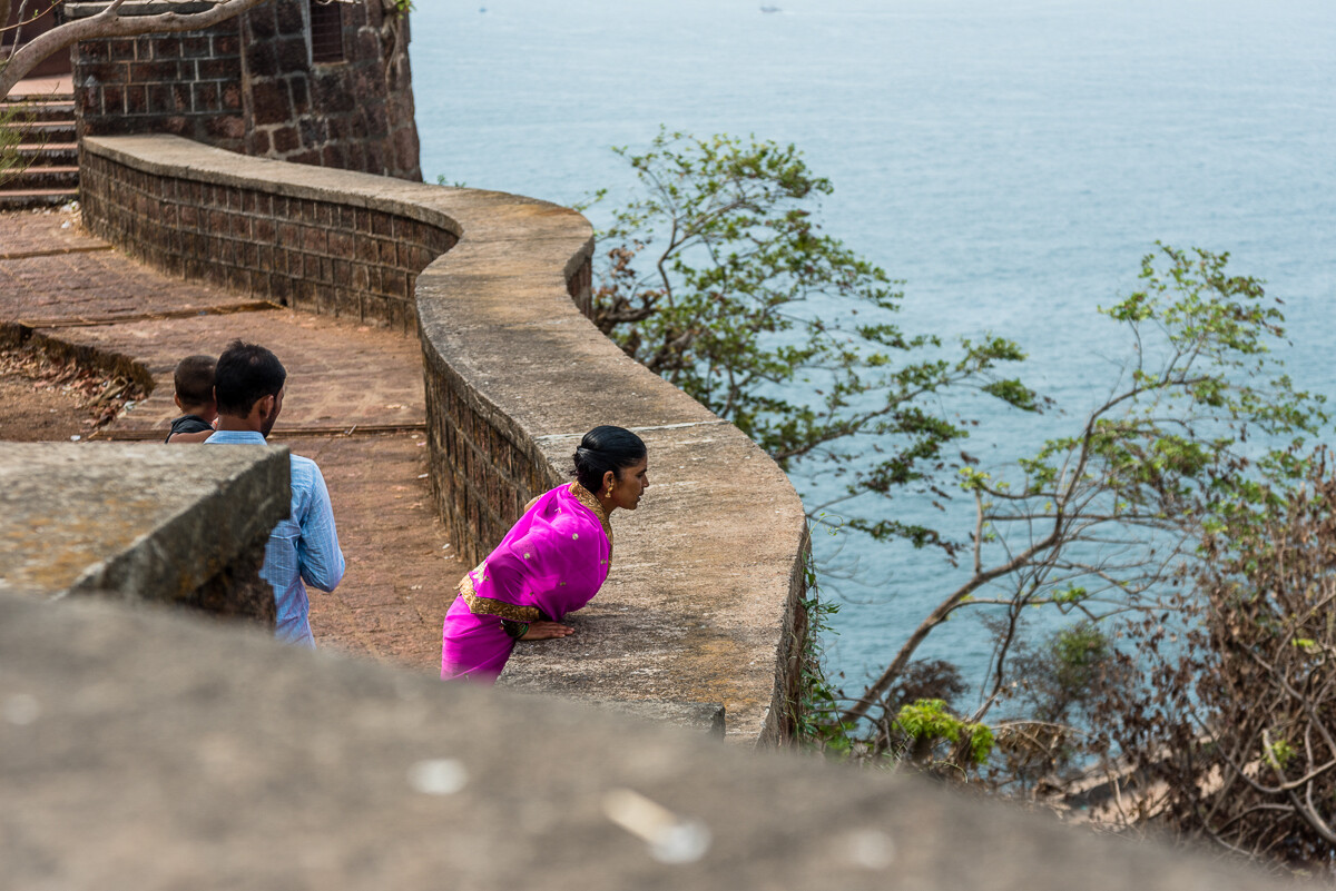 Woman Peers Over Fort