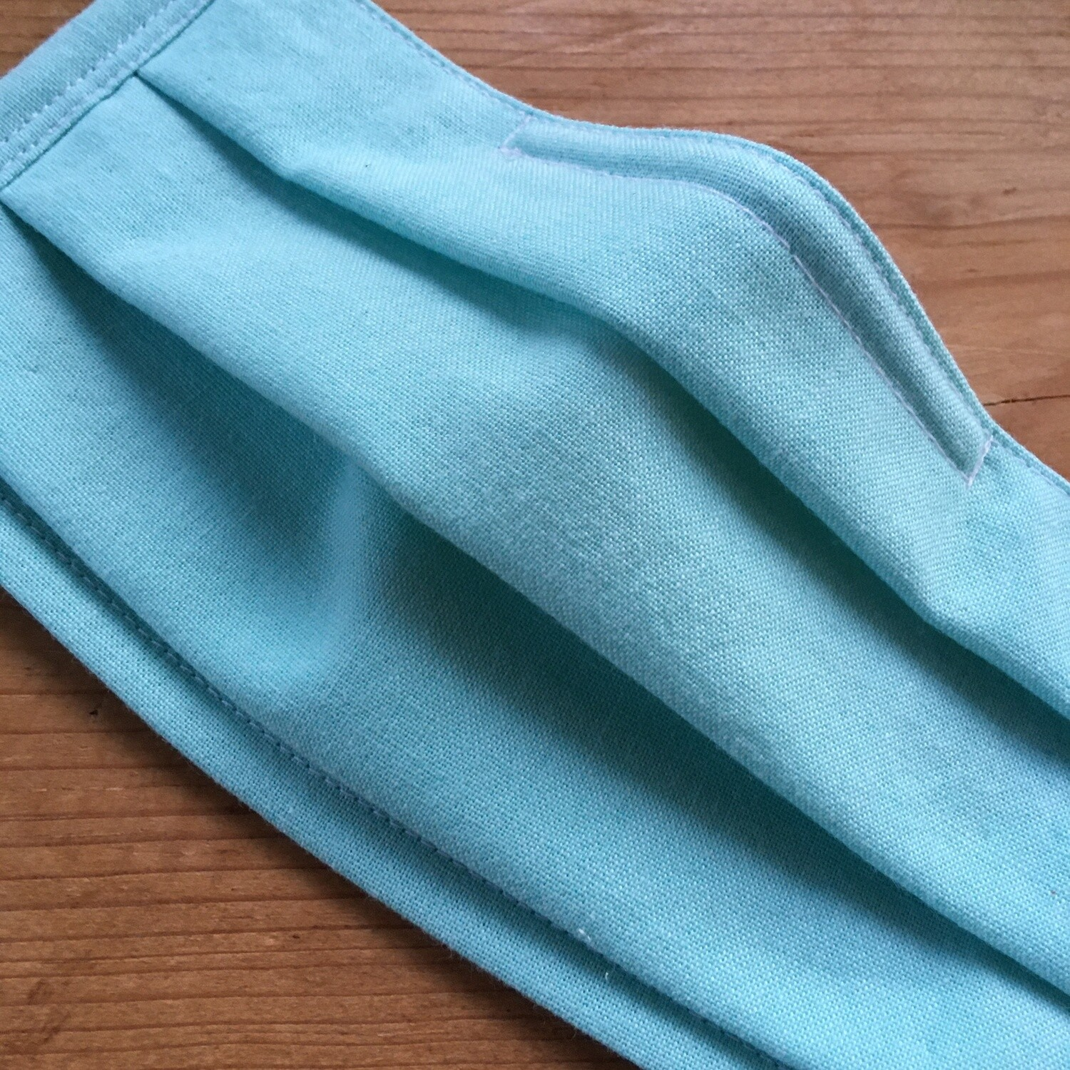 Light Turquoise Face Covering