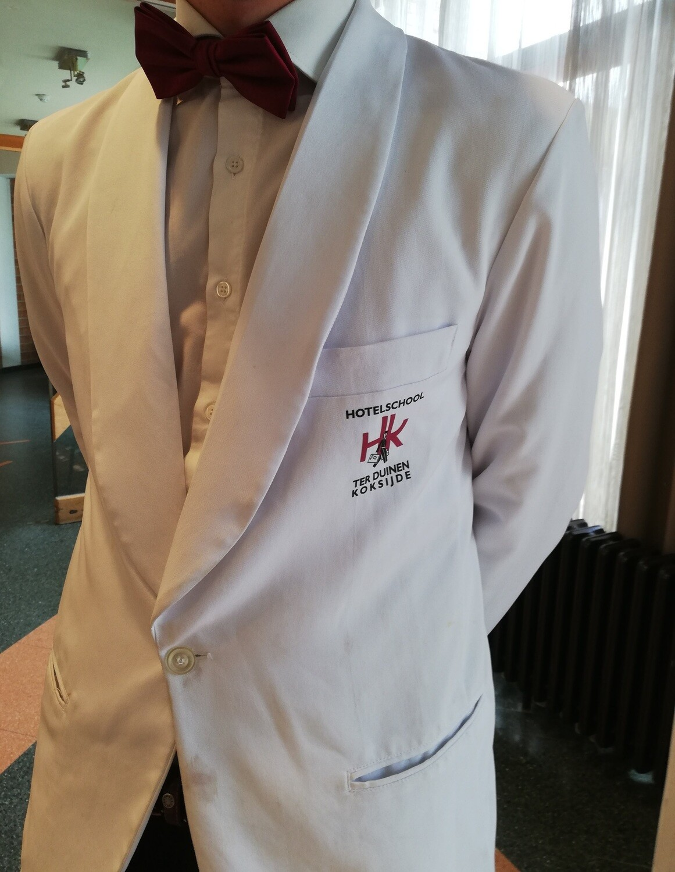 Witte restaurantjas voor service