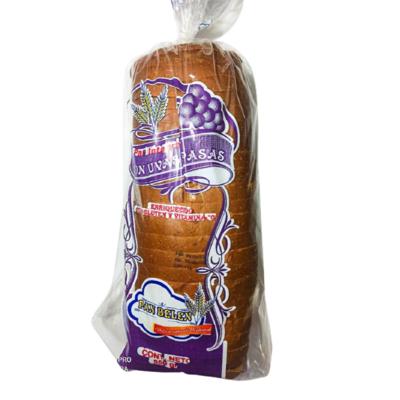 Pan molde integral con uvas pasas Panadería Belén - 1 bolsa
