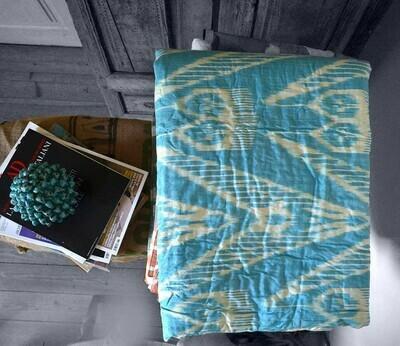 Blue ikat pattern bedspread