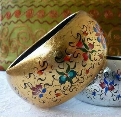 Hand painted bracelet on a golden foil