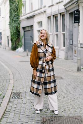 Sleeveless coat Eveni