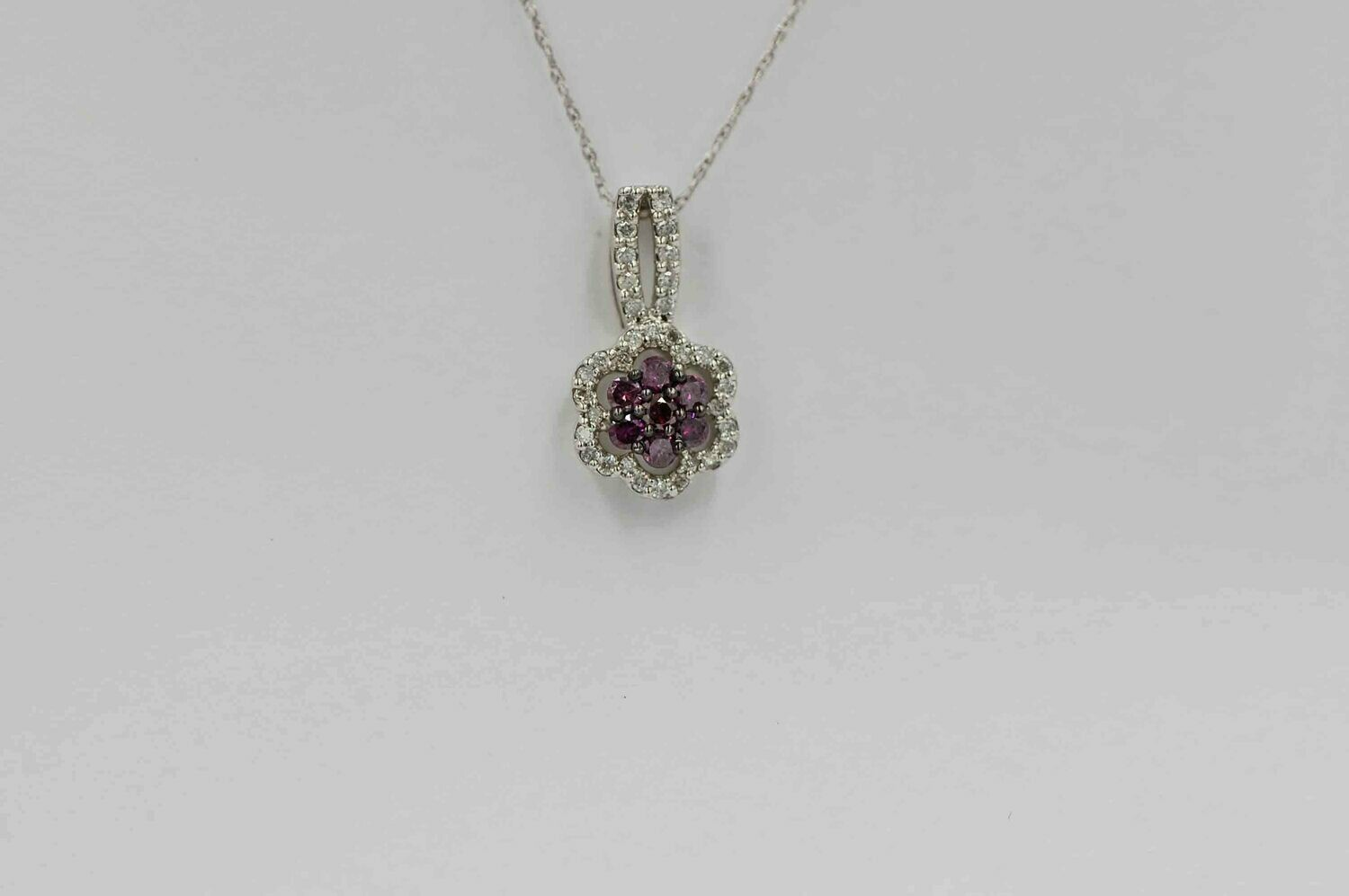 10k wg .33cttw purple & white diamond flower design pd