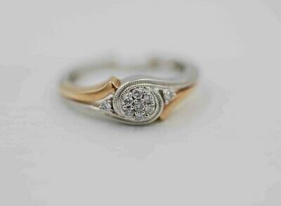 10k yellow & white gold  .12cttw diamond ring