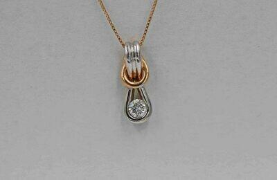 10k yellow & white gold knot style pendant w/ .20ct diamond