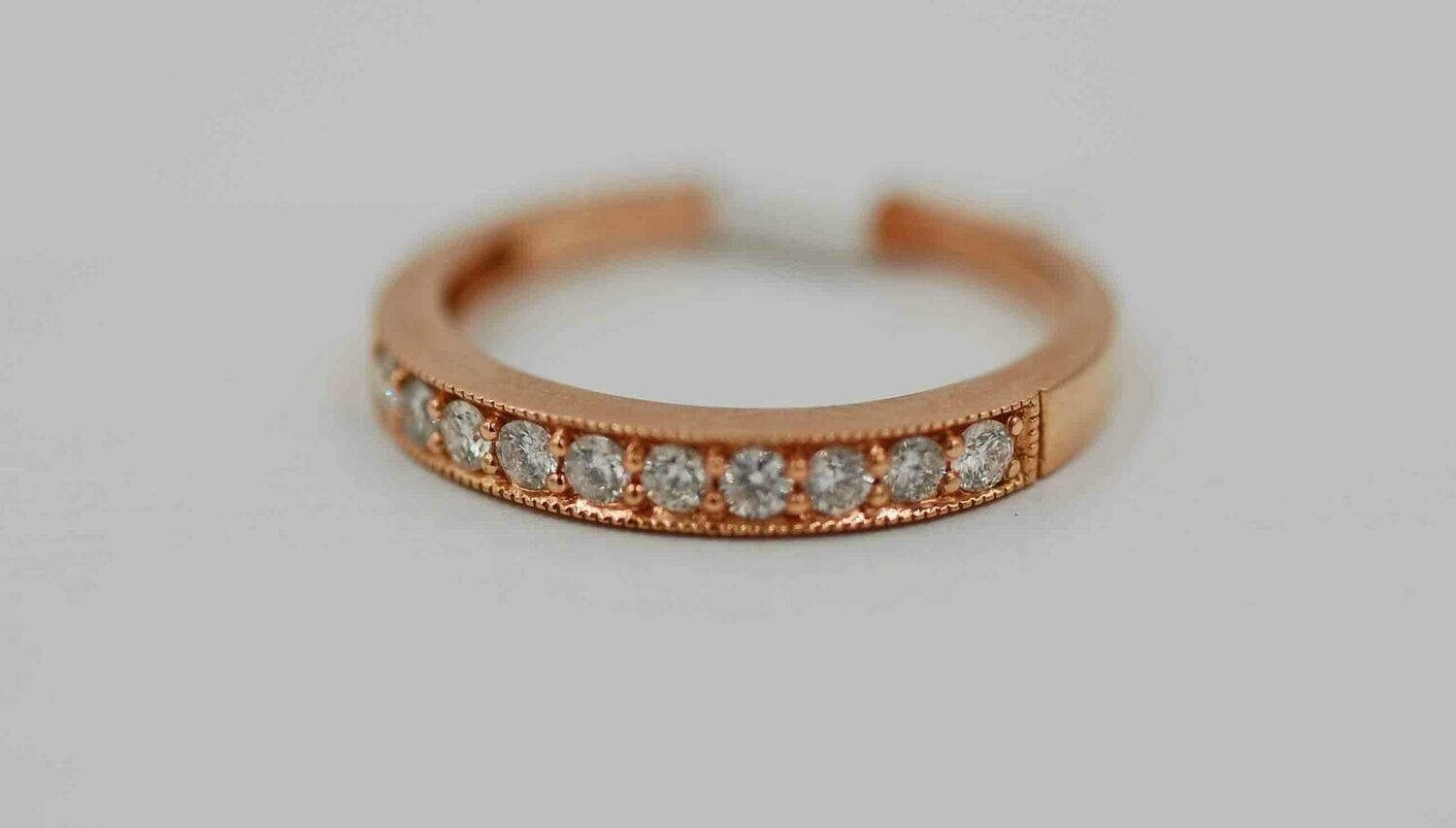 14k rose gold band set with .37 cttw of diamonds w/ millgrain edge