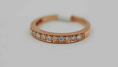 14k rose gold band set with .37 cttw of diamonds w/ millgrain edge