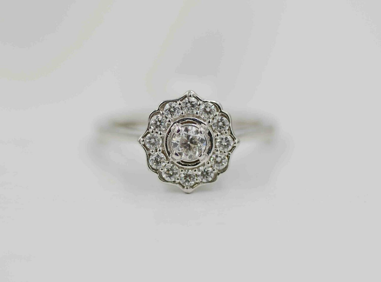 14k wg .52cttw diamond ring /halo w/ points