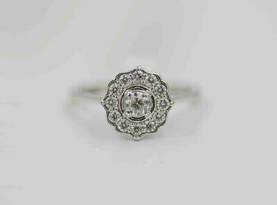 14k wg .52cttw diamond ring /halo w/ points