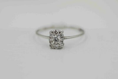 14kw oval shaped diamond cluster w/ RBC ring