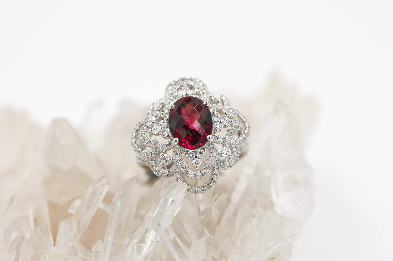 18kwg 2.66ct Oval Rhodolite garnet ring w/ .97cttw diamond accents
