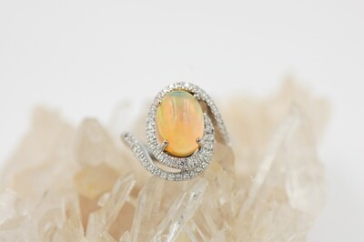 18kw Oval 3.16ct Opal ring w/ .50cttw diamond accents