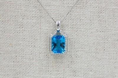 "18k wg 6.19ct Emerald cut blue topaz pendant w/ .23cttw diamond accent - 18"" chain"