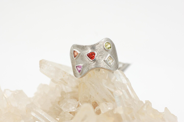 Rainbow sapphire ring w/ multi shape bezel set saph = 1.08cts-.925