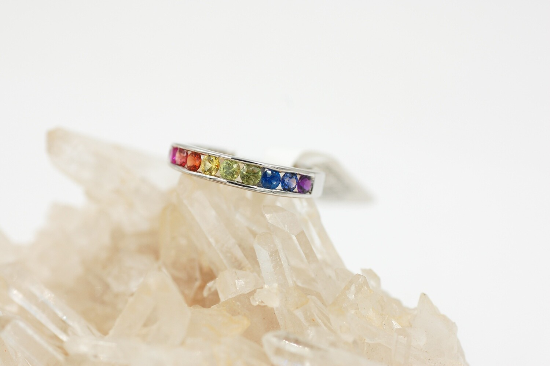 Rainbow sapphire channel set band -.95cts round saph - .925