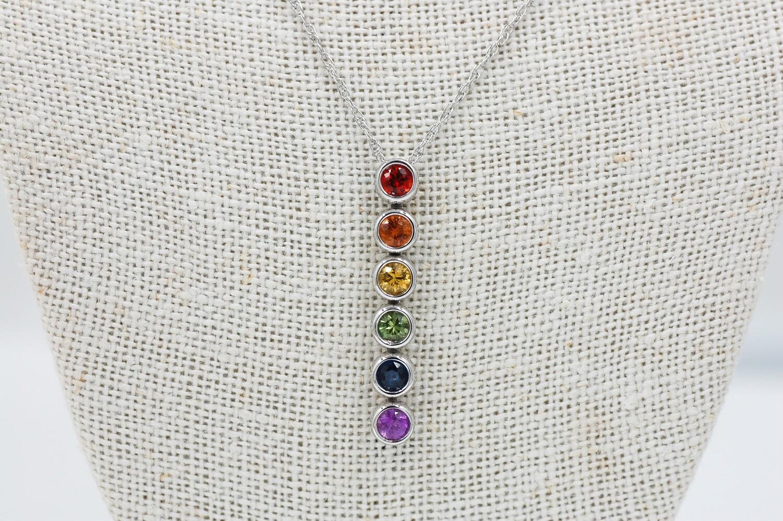 Rainbow sapphire pendant - 1.46cts round bezel set saph- 14kw