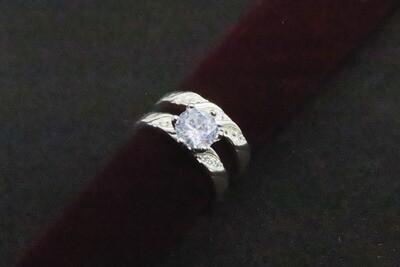 Juego de anillos de matrimonio con circón en plata .925
