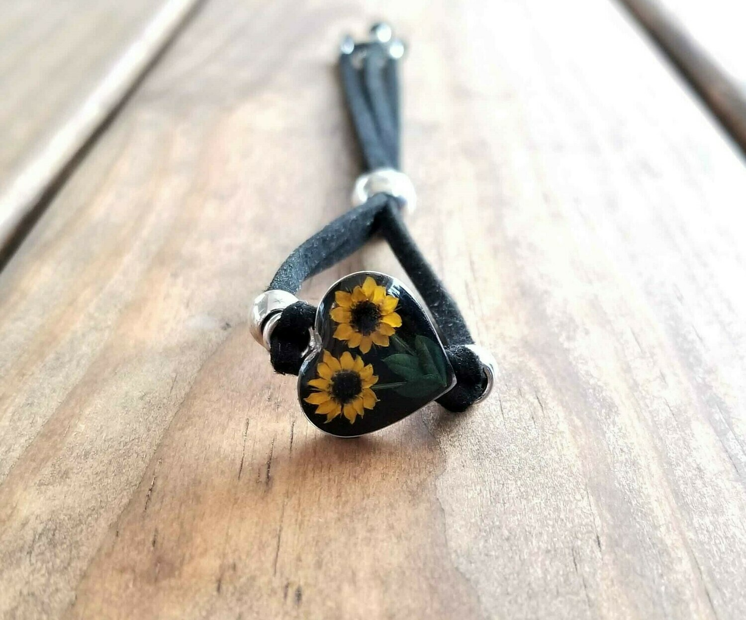Sunflower Heart Leather Bracelet, Black Background.